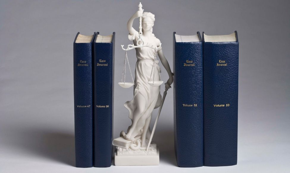 Small Statue with Legal Books